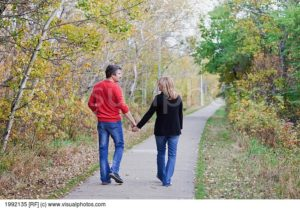 husband-and-wife-walking-in-a-park-in-autumn-st-albert-alberta-canada